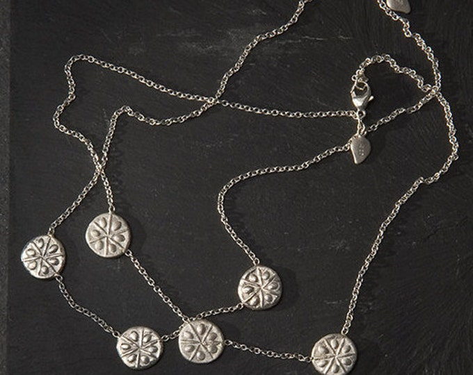 Featured listing image: a triplet sand dollar necklace in silver