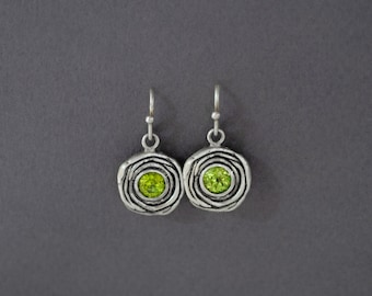 "layered ""flower"" earrings in sterling silver with either garnets, peridots, or amethysts"