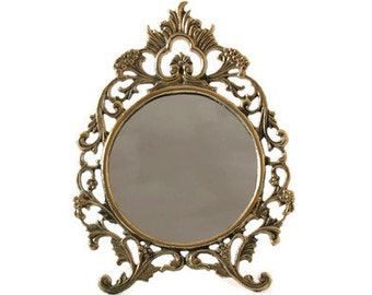 Scrolled Brass Vanity Mirror with Easel Back and Ornate Filigree Design