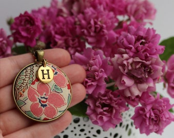 """Add a gold initial charm - available on any 1.5"""" wide round domed pendant"""