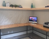 Urban Wood L Shape desk crafted of reclaimed wood with pipe legs