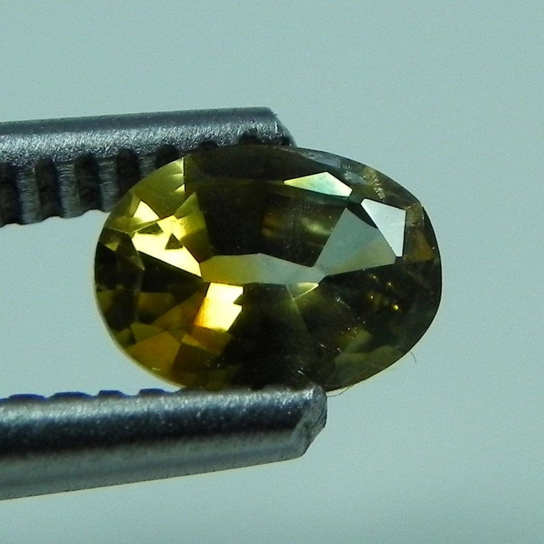 0.95 cts faceted yellow/orange sapphire oval rock creek image 0