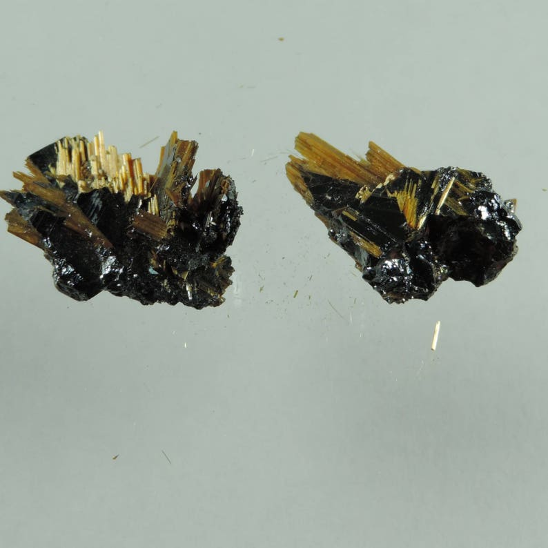 24.15 cts orange hematitewith golden rutile crystal specimen image 0