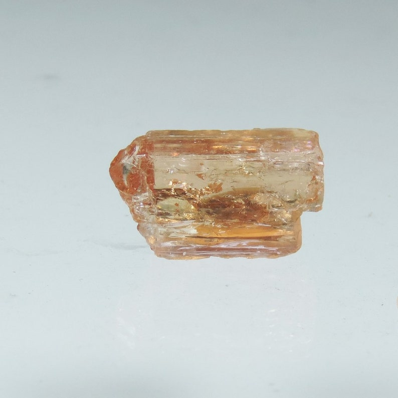 11.5 CTS peach pink imperial topaz rough crystal specimen image 0