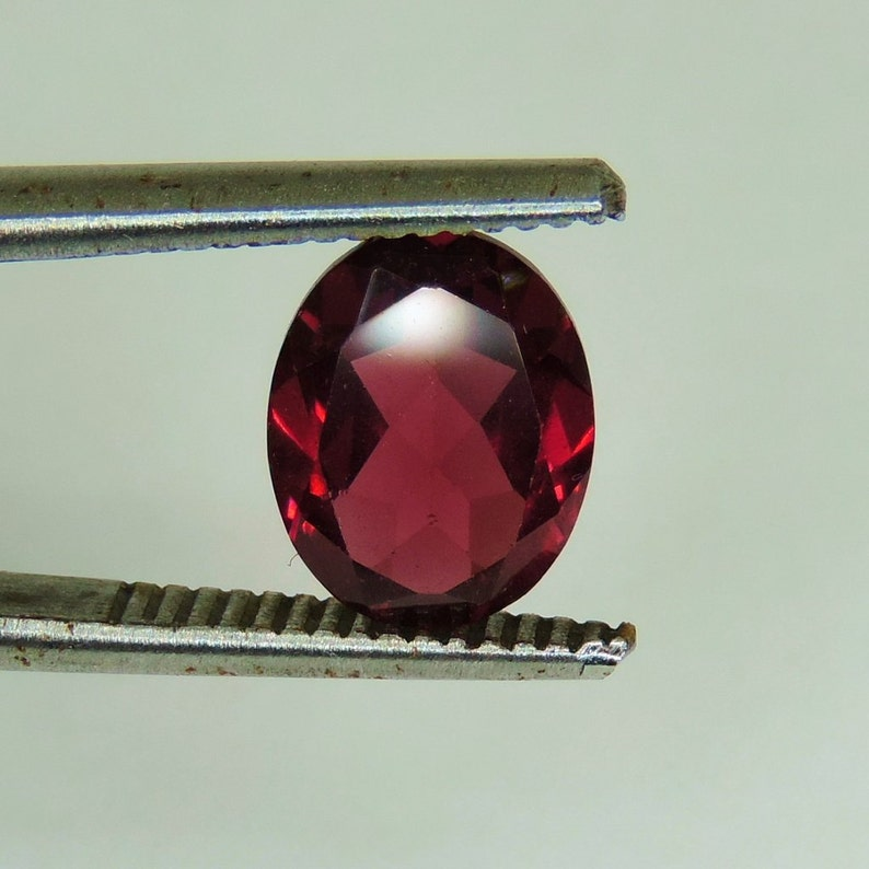 2.6 CTS faceted red Rhodolite Garnet 6 MM oval cut image 0