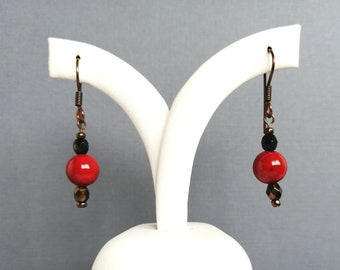 Red and black drop earrings with fossil beads and faceted copper glass