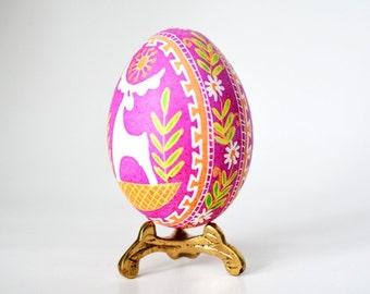 Pink Pysanka batik egg on chicken egg shell Ukrainian Easter egg