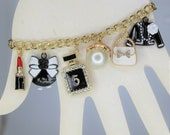 Charm Bracelet, 80 39 s theme bracelet, A bling experience. This bracelet has many gorgeous charms. Check it out.