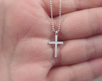 Faith. Tiny Silver Cross Necklace. modern necklace. delicate necklace. simple necklace. minimal necklace. layering necklace. faith jewelry.
