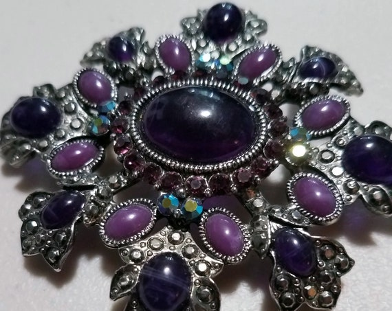 Vintage Wien Signed Purple with Pink Rhinestones in a snowflake shaped brooch.