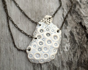 Seed pod necklace.  Wearable sculpture.  Ceramic jewelry.  One of a kind.  Unique.
