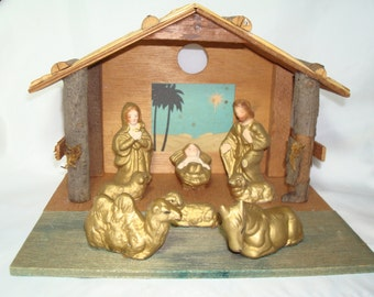 1954 MADE IN JAPAN Wooden Creche with Figurines.
