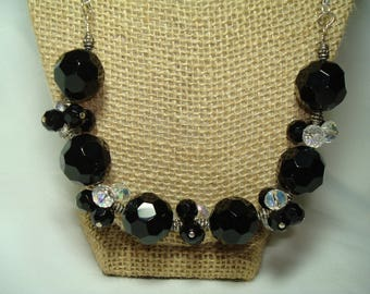 1996 Black Facetted Large and Small beaded Necklace with Crystal Accent Beads .