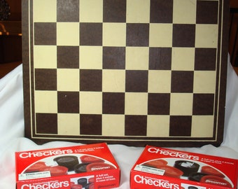 1960's Checkerboard with Two Vintage-New Sets of 1983 Boxed Sets of PRESSMAN Checkers.