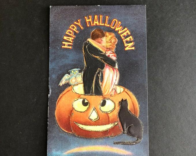 Vintage Halloween Postcard Kissing Lovers in Jack O'Lantern Post Card Ephemera