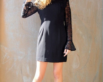 Black cocktail dress with lace sleeves 1990s 1980s