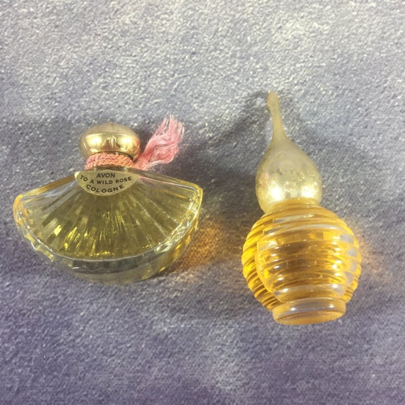 Avon Wild Rose Fan-Shaped Bottle and Other Round Glass Ribbed Bottle with Gold Dome Top