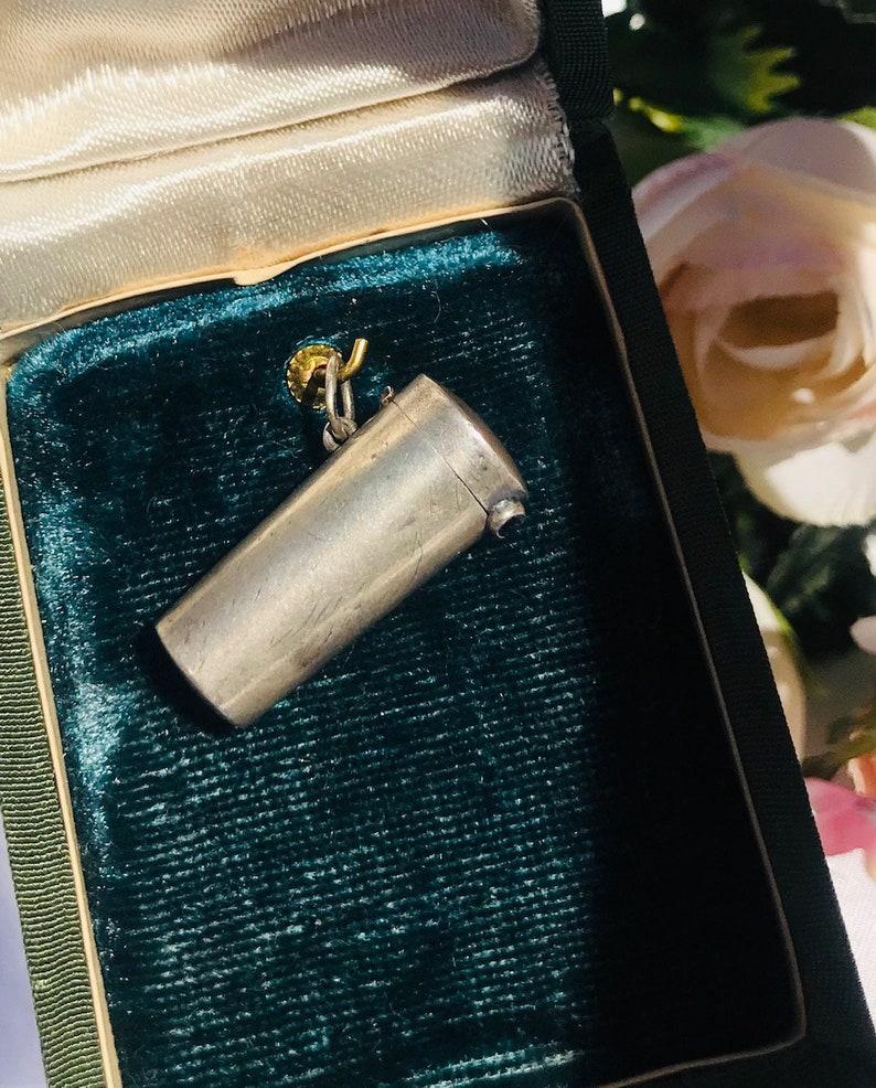 Unique Art Deco antique silver 935 probable German Retractable Cigar Holder Miniature Locket Pendant with a small sapphire.