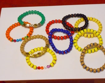 Stretchy Bracelets in Bold, Manly Colors for the Young Man in Your Life.  Pick Ready Made or Custom Made.  Acrylic Beads