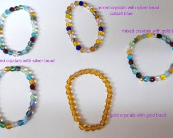 Stretchy Beaded Bracelets ... Fire Polished Faceted Czech glass bracelets ... will fit small to medium wrists ....   item #28b-710