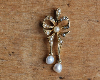 Antique Edwardian 14K bow pendant with seed pearls