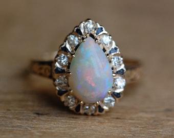 Antique 14K Art Deco opal teardrop halo ring with enamel detail