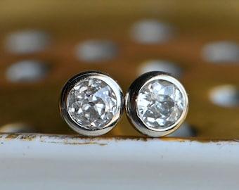 Antique 14K .34 CTW bezel set old mine cut diamond stud earrings