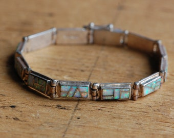 Vintage Southwestern sterling silver and white opal inlay bracelet
