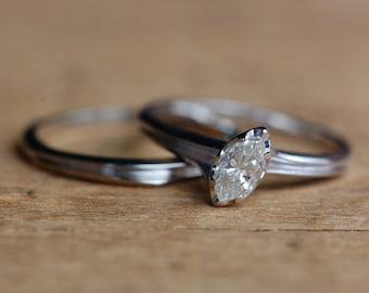 Vintage .25 carat 14K white gold elegant marquise solitaire bridal set
