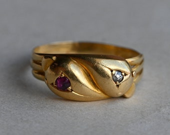 Antique 1910s English 18K entwined serpent snake ring with diamond and ruby heads
