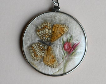 Vintage double-sided pendant medallion with pressed butterflies