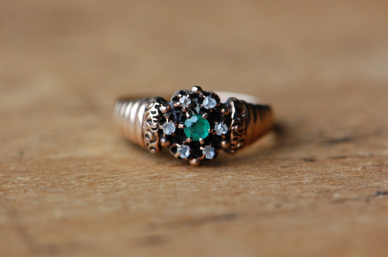 Antique 1910s simulated emerald and rose cut diamond halo image 0