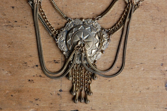 Antique 1930s ornate cast brass festoon necklace