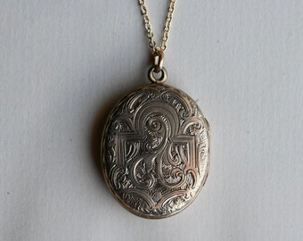 Antique early 20th century oval photo locket hand engraved on both sides