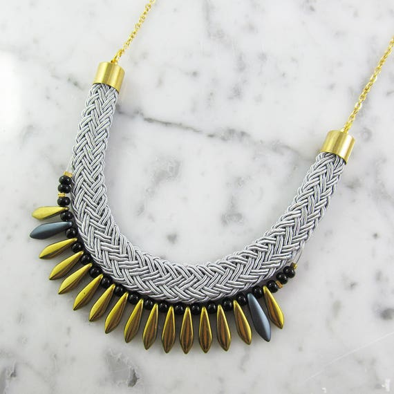 Ajustable necklace on stainless gold chain with gold, glass beads and black seed bead on gray braided polyester cord, les perles rares