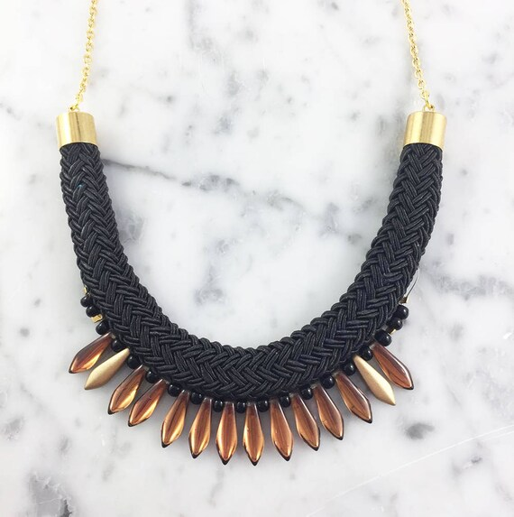 Ajustable necklace on stainless gold chain, bronze glass beads and black seed bead on braided polyester cord, les perles rares