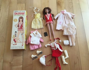 Skipper, Barbies little sister, with box and 4 extra outfits  Stock no. 0950 Brunette, 1963