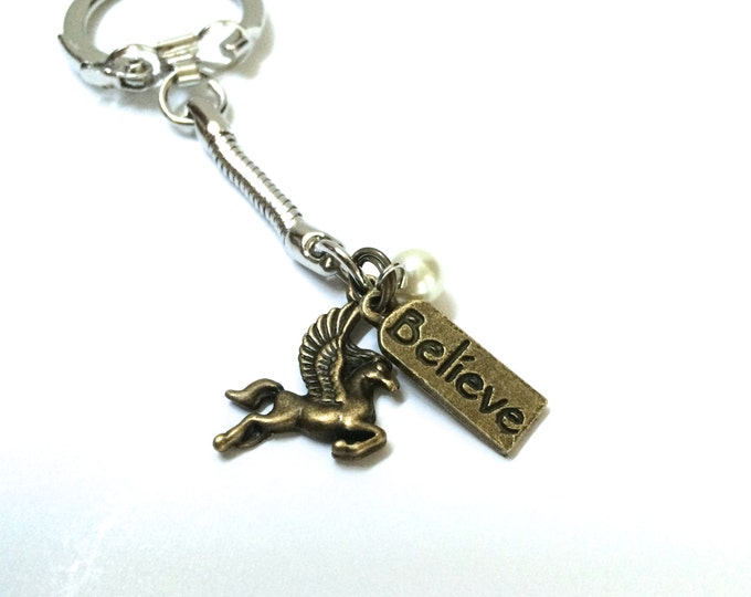 Believe in Pegasus Keychain, in antique gold, with three charms, custom gem color available, pegasus keychain