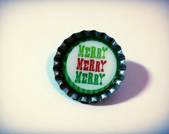 Christmas bottle cap pin, button, reads, merry, merry, merry, earth conscious, brooch