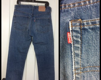 Vintage Levis Faded Blue denim 505 33X31, measures 32x30 Straight Leg 1980's made in USA Boyfriend jeans Talon zipper black bar stitch #261