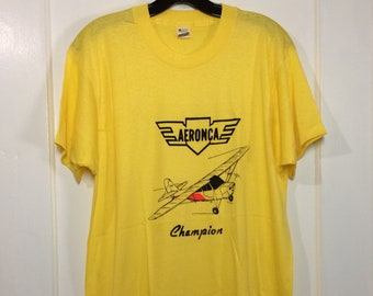 deadstock 1980s Aeronca Champion small airplane t-shirt size XL 21x28.5 pilot aircraft yellow thin Screen Stars made in USA neon print NOS