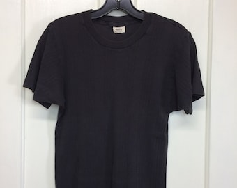 1980s faded black soft ribbed cotton plain blank t-shirt size small 15x25 single stitch made in USA by Jockey athletic cut