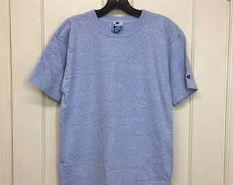 1990s Champion brand logo patch heather blue t-shirt size large 19x27 made in USA sports gym cotton rayon single stitch