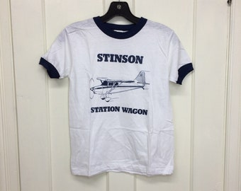 deadstock 1980s Stinson Station Wagon airplane t-shirt size youth 14-16 15x20 aviator pilot aircraft white blue ringer Hanes made in USA NOS
