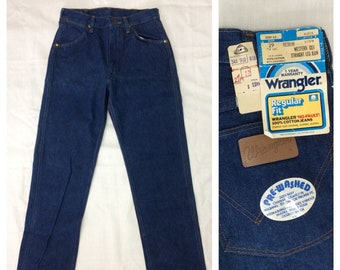 deadstock 1970s Wrangler western cut straight leg jeans tag size 29, measures 27 x 30 made in USA medium dark wash blue denim NOS NWT #382