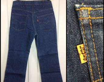 8681c82b7d5 1980s Levi's 517? boot cut flare dark wash blue jeans measures 31X28 orange  tab made