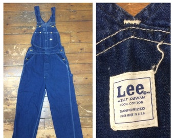 1960s Lee Jelt denim indigo blue overalls measures 31 x 32 sanforized Union made in USA donut hole buttons farmer workwear carpenter