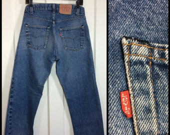 1980s faded Levi's 505 34X30, measures 32x29 Straight Leg made in USA black bar stitch denim Boyfriend blue jeans #314