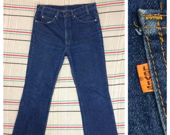 1980s Levis orange tab 517 boot cut jeans measures 33X30 dark wash denim flare blue jeans made in USA #386