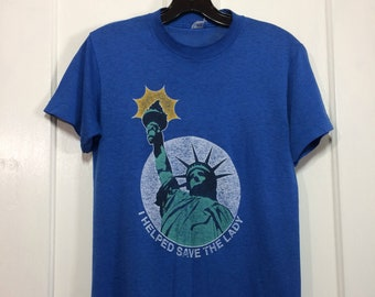 1980s worn paper thin Statue of Liberty New York City souvenir t-shirt looks size small 16x25 faded blue NYC I helped save the lady